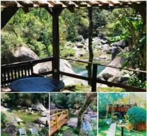 Chalé suspenso em madeira em meio a mata e deck com vista do o rio de Visconde de Mauá